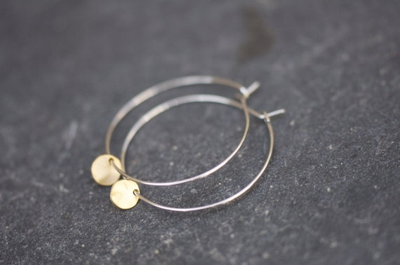 Tiny gold coin charm on delicate white gold silver hoop earrings