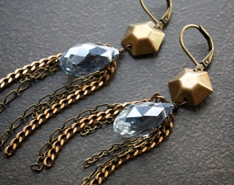Pale Blue Luster Crystal Drop Earrings With Slinky Brass Chain Dangles and Geometric Connectors