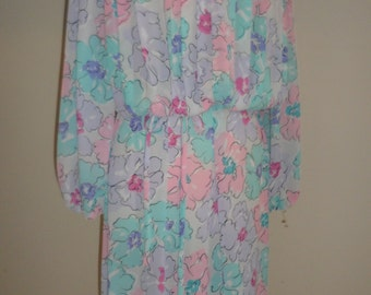 its a lehigh  dress spring pastel   flowers  union tag  very sheer feel  light look  marked size  12  meds to larger  please see measures