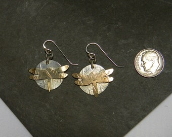 Dragonflys made of bronze metal soldered onto sterling silver disks