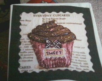 finished cross stitch cupcake