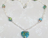 Wildflower Millefiori heart pendant necklace in bright colors of teal, yellow, orange, aqua & cobalt blue on Figaro silvered chain. OOAK
