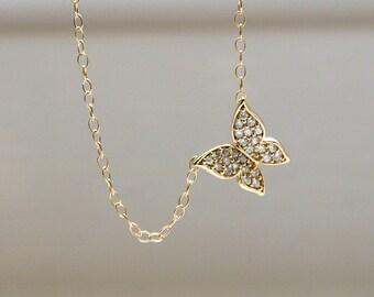 Sideways butterfly necklace
