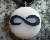 Infinity symbol hand carved on a polymer clay translucent white color background. Pendant comes with a FREE 3mm necklace.