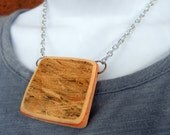 Save the Planet Green Recycled Skateboard Necklace - Scratches and Brown Punk Skater Fashion by TakeTwoSkateShop