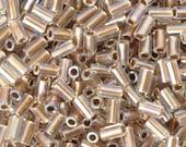 Seed Beads-3mm Bugle-994 Gold Lined Rainbow Crystal-Toho-15 Grams