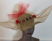 gold red art deco hat
