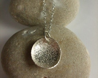 Sterling silver necklace with pebble shaped pendant