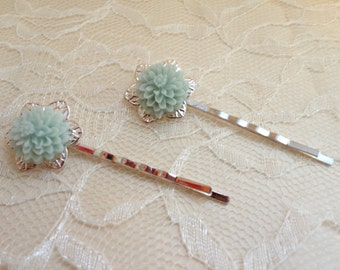 A Pair of Silver Filigree Bobby Pins with Resin Flower
