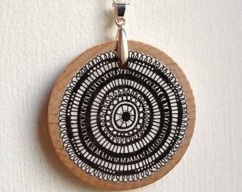 Hand drawn wooden pendant black on white no3