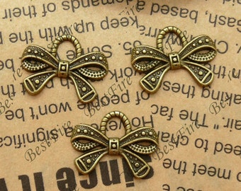15PCS Of 14x19MM  Antique Bronze lovely bowknot Charm Pendant,metal finding,pendant beads
