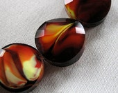 """Black Red Yellow White Millefiore Faceted Crystal Beads, 14mm x 7mm twisted coin shape,  25 pieces, 14"""" strand"""