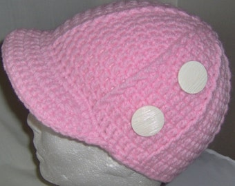 Crocheted newsboy hat with Ribbed, fit head size 21-22 inches around.