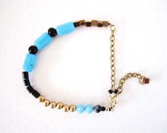 Mixed media bracelet, stacking bracelet, vintage bead bracelet, handmade bracelet, blue, black, gold, onyx by nicobel