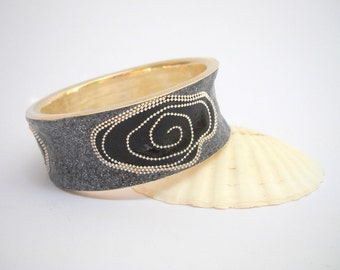 Sterling silver cuff bracelet. Bangle bracelet. Designed with black spirals in dotted grey. Trendy gift for women.