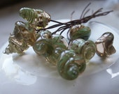 10 SeaShells Handmade Lampwork Headpins Celadon on Honey Transparent on Soft Cooper Wire.
