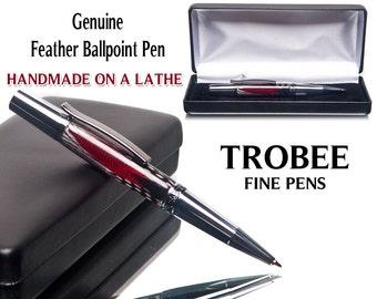 Easy to write, smaller sized ballpoint feather pen. Handmade on a lathe