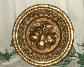 Vintage brass wall plate brass plaque made in England embossed Brass plaque with depictions of fruit brass Peerage plates
