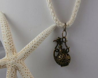 Bronze Decanter Bottle and Cream Sea Rope Necklace