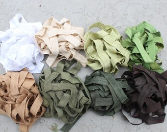 Fold over elastic 8   colors 4  yards of each color white/cream blue red green orange/peach yellow  lavender/purple  gold.