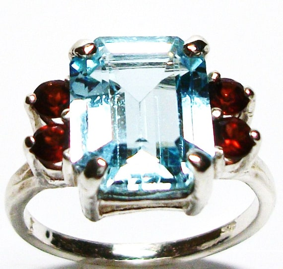 "Sky blue topaz ring w/ double garnet accent   s7  set in solid sterling silver   ""Blue Lagoon"""