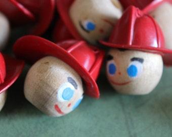 2 Vintage Wooden Firemen Heads