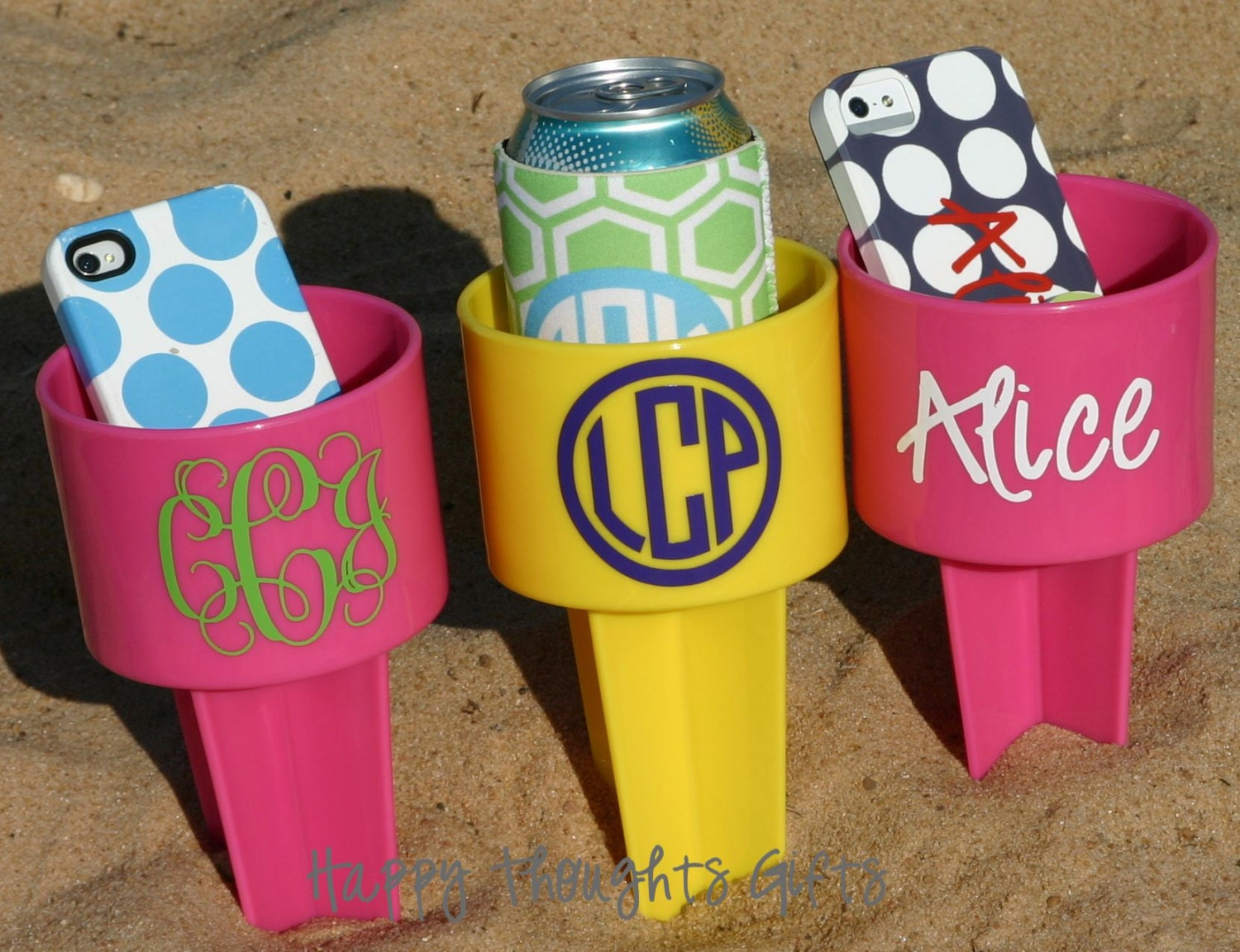three monogrammed beach drink holders sand spiker