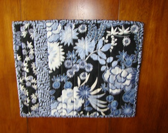 Set of four quilted blue floral placemats
