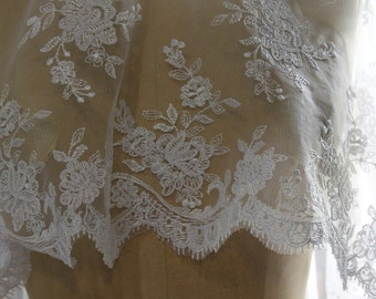 Ivory Lace Netting Fabric with Allover Embroidery with scalloped eyelash edges on both sides. 50 Inches Wide
