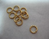 Gold Jump Rings 8mm Twisted 16 gauge QTY - 15 LAST LOT