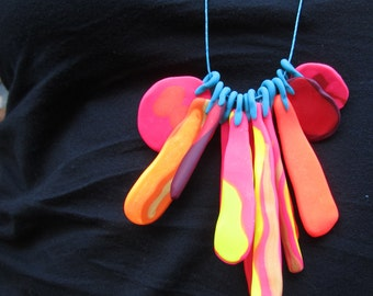 warm coloured pinks oranges yellow gold summer coloured 12 piece eclectic 'feather' necklace