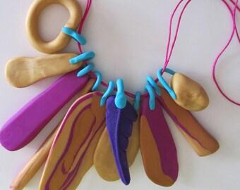 purples, violets, golds 10 piece eclectic 'feather' necklace