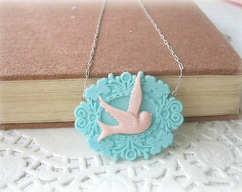 ON SALE  Pink Swallow in Blue Frame Necklace