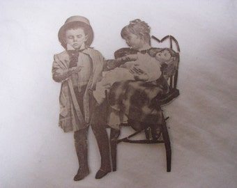 Victorian scrap art cut out children playing doctor Victorian doll