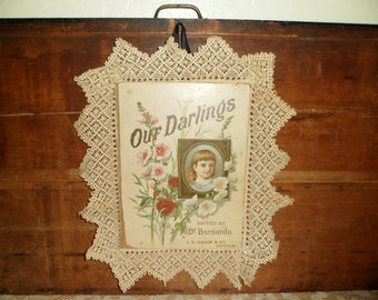 antique children's book cover ,  antique advertising , lace wall hanging