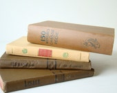 french book bundle in shades of brown and green, french home library decor, book stack, hardback books, decorator books