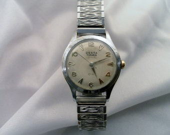 Vintage 1960's Desta - Swiss Amko Watch Co 17Jewel Mechanical Date Watch. Silvertone Dial, Stainless Steel Band. Winds and Sets, Works.