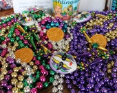 Mardi Gras beads and Coca-cola glass