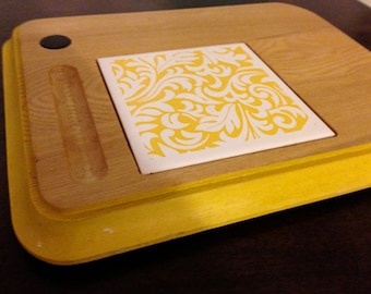 Yellow wood and tile  trivet with  ceramic tile center