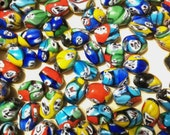 Millefiori glass larger beads Priced to SELL. 6 for 1.60...Oval barrel, multicolor, Italy Venice Murano