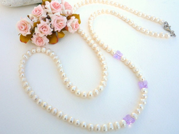 Long freshwater Pearl necklace with Swarovski butterflies.