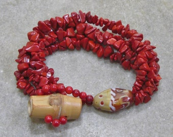 Red bamboo coral bead and imitation coral chip bracelet