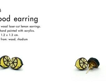 Wood laser-cut lemon earrings.