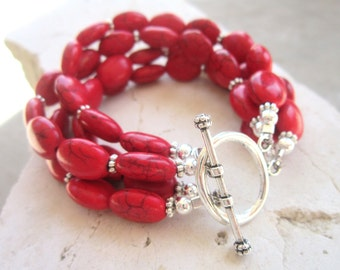 Red Beadwork Turquoise Bracelet. Red Howlite Multi Strand Bracelet. Red Semi Precious Stone Bracelet. Red Toggle Bracelet. Red Jewelry