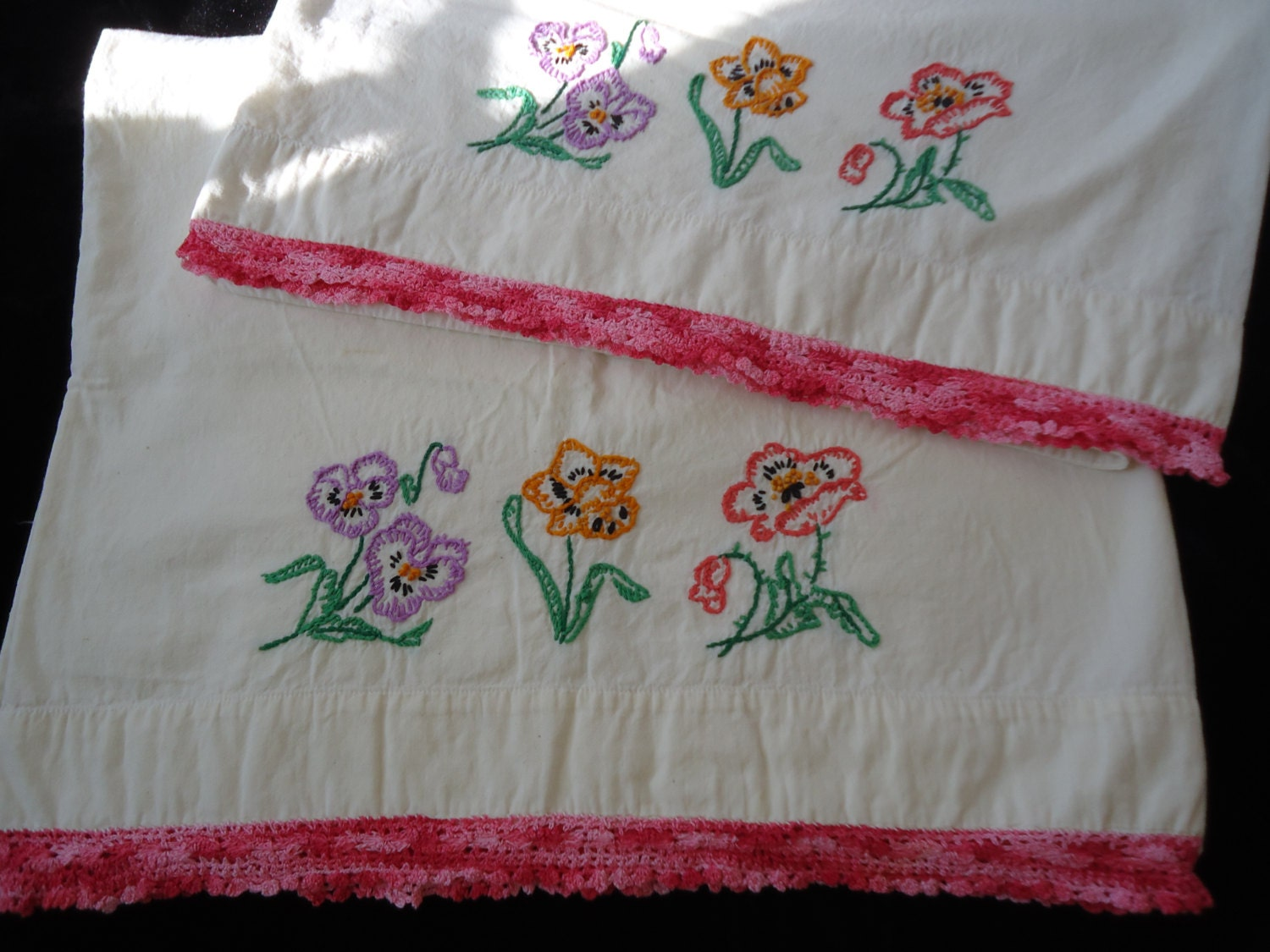 Vintage embroidered pillowcases with flowers