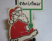 1940's-50's unused die cut christmas gift tag santa claus carrying  sign do not open till christmas