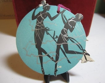 Art deco  colorful 1920's unused Buzza  die cut and silver gilded bridge tally card silhouette of female greek goddess dancing nymphs
