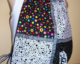 dots of all colors on a blue ripstop nylon drawstring backpack with front zipper pocket