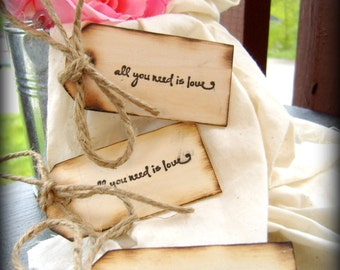 Set of ten either All you need is love or First comes love distressed tags