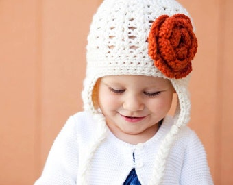Warm Crochet Beanie with Tassles, Earflaps and Attached Flower